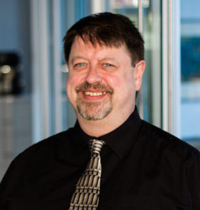 Photo of Stephan Pigeon, a core member of our marketing + graphic design company for many years.